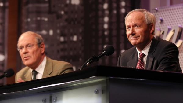 Theodore Dalrymple (left) and Asa Hutchinson argue against legalizing drugs in an <em>Intelligence Squared U.S.</em> debate.
