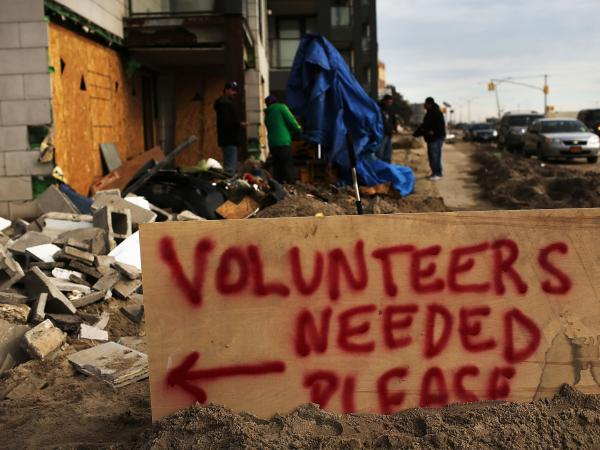 In New York City's Rockaway neighborhood, a sign asking for help in the clean-up.