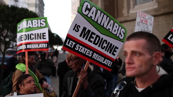 Medical marijuana advocates demonstrate outside a San Francisco fundraiser for President Obama in February.