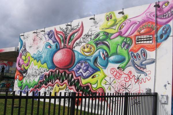 Los Angeles artist Kenny Scharf's cartoonlike mural greets visitors to Wynnwood Walls.