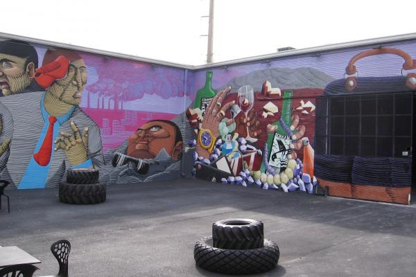 The second wall of Nunca's mural references Miami's material culture.