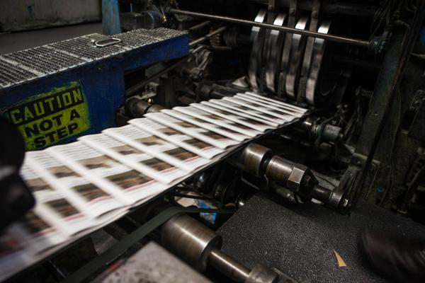 Copies of <em>The Orange County Register</em> slide through the presses. The <em>Register</em> is the country's 20th most-read daily, with a circulation of about 285,000.