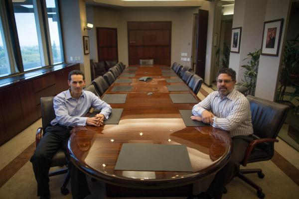 <em>Orange County Register</em> publisher Aaron Kushner (left) and company president Eric Spitz. This summer, Kushner's Boston-based investment firm, 2100 Trust, bought Freedom Communications and the<em> Register</em>.