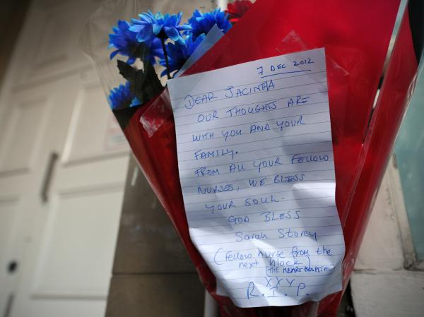 Flowers and a note outside the apartments near King Edward VII Hospital in central London where Jacintha Saldanha and other nurses stayed.