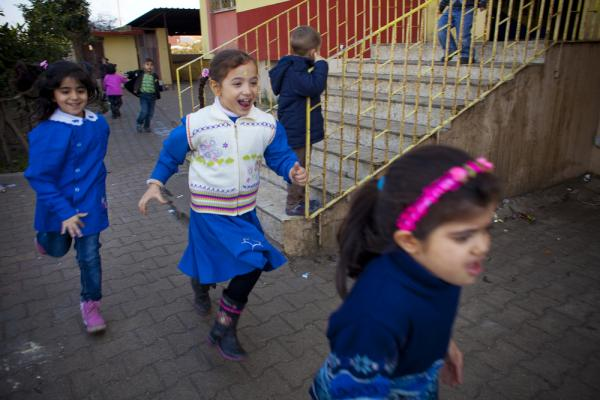 Children play during recess. The school is overcrowded with 500 students and new students constantly arriving. In one recent week, 115 new students enrolled.