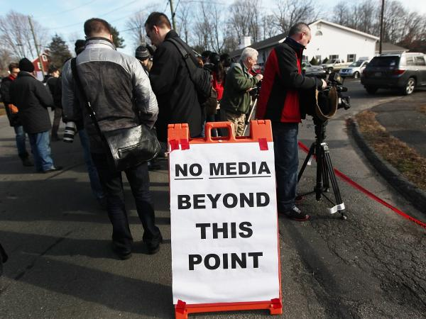 Media gather in Newtown, Conn. on Dec. 15, 2012 as the community copes with the elementary school shooting.