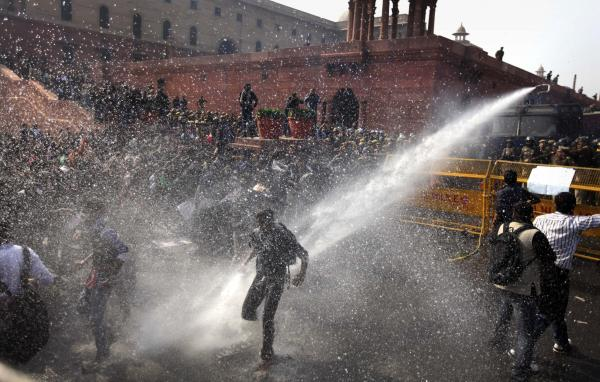 A water cannon targets protesters during their march toward the presidential palace in New Delhi on Saturday.