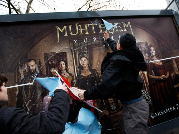 Demonstrators attack a billboard advertising the TV series <em>The Magnificent Century</em> during a protest in Istanbul on Jan. 9, 2011.