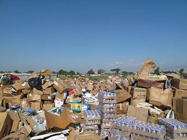 Unsolicited donations of used clothing, bottled water, canned food and personal grooming products piled up following the 2010 earthquake in Haiti. The piles had to be moved aside to make room to stage and deliver critical relief supplies.