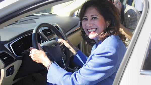 Secretary of Labor Hilda Solis, seen here sitting in a new Ford Fusion last September, submitted her resignation to President Obama Wednesday.