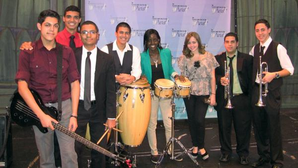 The young musicians of Seguro Que Si will perform in this weekend's Inaugural Parade. Left to right: Daniel Chico (bass), Kevin Arguelles (piano), Maxwell Frost (timbales), Christopher Muriel (congas), Niyah Lowell (bongos), Annette Rodriguez (vocal), Sean Fernandez (trumpet), Robby Cruz (trumpet).