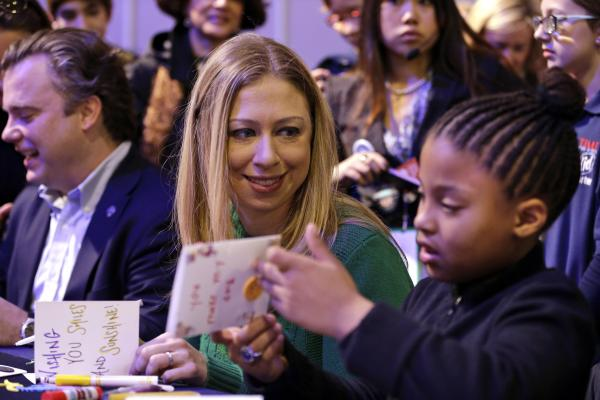 Chelsea Clinton makes cards with 8-year-old Addison Rose on the National Mall on Saturday as part of the National Day of Service events. Clinton, daughter of former President Bill Clinton and Secretary of State Hillary Clinton, is the honorary chair of the National Day of Service.