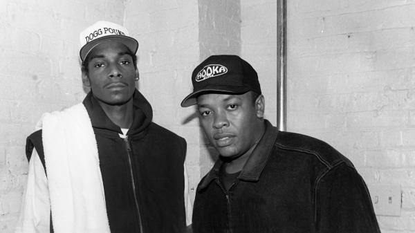 Dr. Dre (right) with Snoop Dogg, who played a starring role on Dre's <em>The Chronic</em>. Here they pose after a 1993 performance in Chicago.