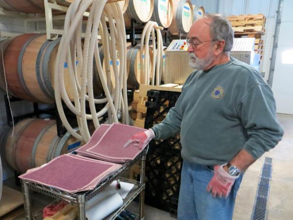 John Larson, owner of Snus Hill Winery in Madrid, Iowa, blends wine from Iowa grapes with grapes from other parts of the country. He says the area's lack of rain was really good for grapes.