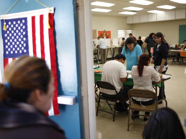 Latino voters, shown here on Election Day in Los Angeles, will grow in electoral power by the year 2020.