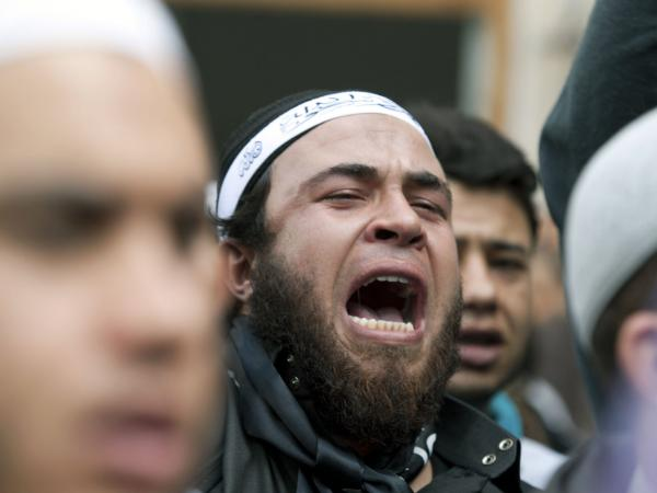 A demonstrator shouts anti-government slogans as he stands in front of the Justice Ministry in the Tunisian capital, Tunis, on Nov. 6, 2012, as part of a demonstration by radical Salafi Muslims protesting against the imprisonment of hundreds of Salafist militants.