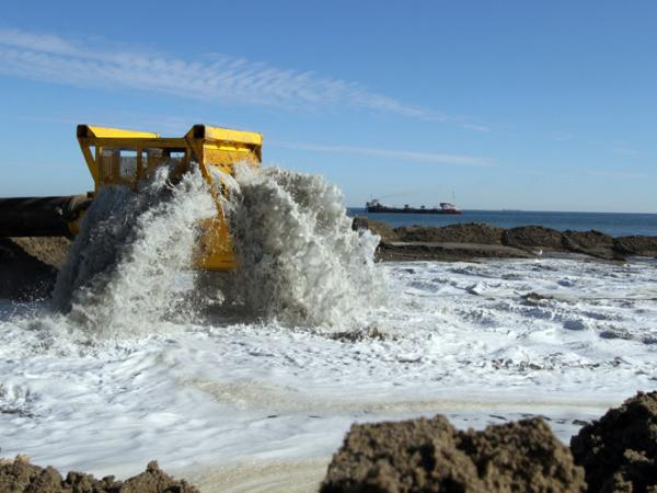 Workers reconstruct a section of Virginia Beach. The federal government finances 65 percent of beach nourishment projects; local governments pay for the rest.