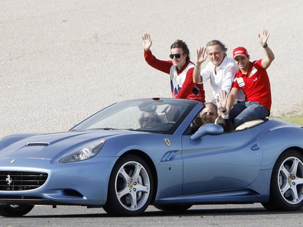 In 2009, Formula One driver Fernando Alonso (from left), Ferrari President Luca Cordero di Montezemolo and Ferrari F1 driver Felipe Massa ride in a Ferrari driven by Valencia's then-regional government president Francisco Camps.