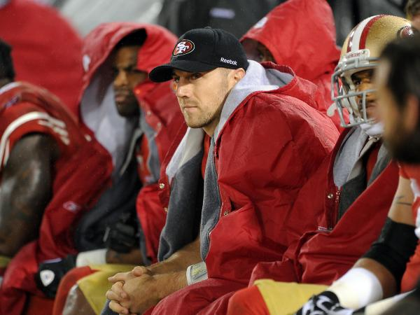 San Francisco 49ers quarterback Alex Smith looks on from the sidelines during the overtime period against the New York Giants on Jan. 22, 2012, in San Francisco.
