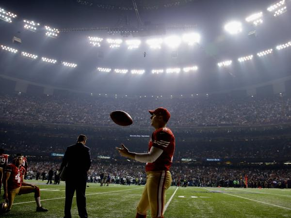 Kicker David Akers of the San Francisco 49ers waits during a power outage that occurred in the third quarter that caused a 34-minute delay during Super Bowl XLVII.
