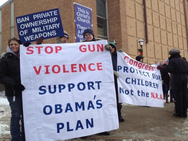 Supporters of gun control laws await President Obama's appearance Monday outside the Minneapolis Police Department's Special Operations Center.