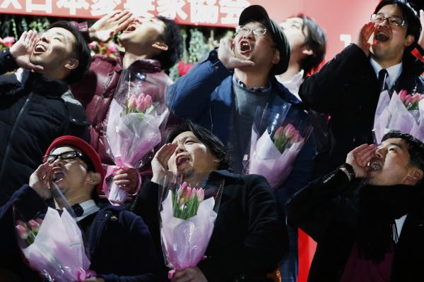 "Men shout messages of love during the annual event. One Japanese writer says the country has ""always been in a crisis romance-wise."""