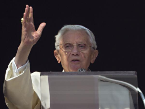 Pope Benedict XVI acknowledges a cheering crowd of faithful and pilgrims during the Angelus prayer from the window of his apartments at the Vatican on Sunday.