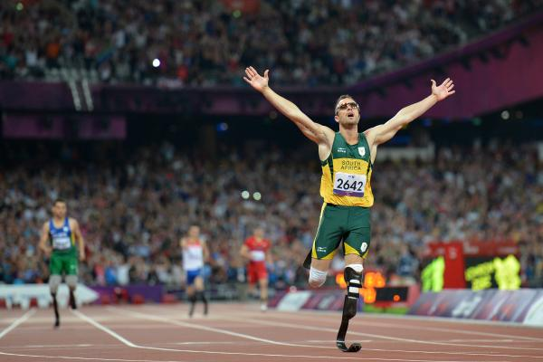 Oscar Pistorius, seen here at the London 2012 Paralympic Games, made history as the first double leg amputee to race in the Summer Olympics. He now faces charges that he murdered his girlfriend.