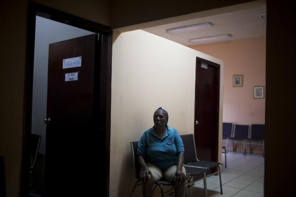 Nolvia Cruz waits to be seen at an HIV/AIDS health clinic on Jan. 25 in La Ceiba. Nolvia is open about her diagnosis, but many people are afraid to go to the clinic for fear that someone they know will see them and gossip about their HIV status.