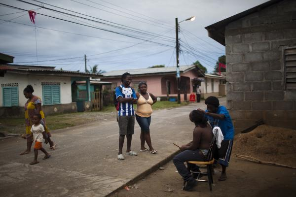 Daily life on the streets of a Garifuna community Jan. 25 in Corozal, Honduras. Various factors have contributed to a high HIV rate among the Garifuna, including poverty and migration.