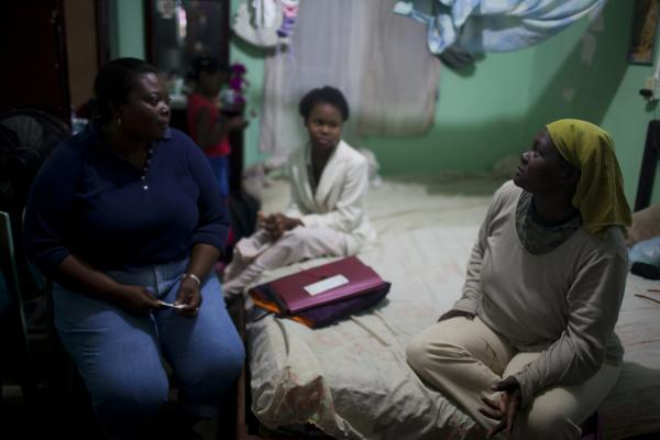 Carmen Suyapa (right) receives a visit from Anatolia Ramirez on Jan. 21 in La Ceiba, Honduras. Carmen felt so rejected by her family after she was diagnosed with HIV that she briefly considered committing suicide.