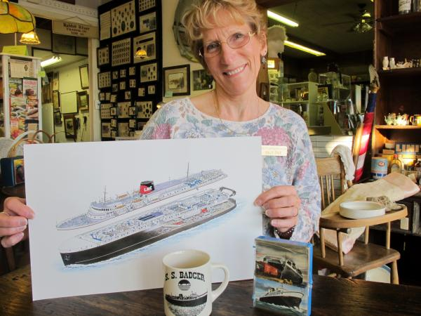 Sally Cole, co-owner of Cole's Antiques Villa in Ludington, Mich., displays some of the shop's memorabilia from the SS Badger.