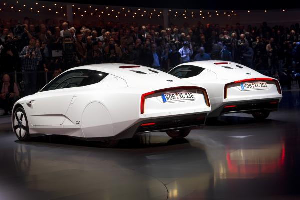 Two new Volkswagen hybrid XL1 model cars are displayed during a preview of Volkswagen ahead of the Geneva Car Show in Geneva.