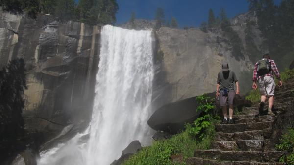 Hikers walk on the Mist Trail to Vernal Fall at Yosemite National Park in California. The National Park Service has to cut $134 million from sites around the country, including Yosemite, due to the lack of a budget deal in Congress.