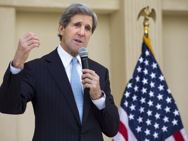 U.S. Secretary of State John Kerry speaks to U.S. Embassy staff in Doha on Wednesday.
