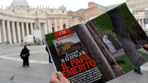 In Vatican City's St. Peter's Square on Wednesday, a man looked at  the Italian magazine <em>Chi</em>'s photo of former Pope Benedicxt XVI — the first such image since he stepped down last week.