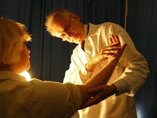 A doctor checks for signs of skin cancer at a free cancer screening day in New York City.