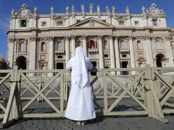 Outside Saint Peter's Basilica in Vatican City on Tuesday, a nun prayed. In the Sistine Chapel, cardinals were beginning their conclave to select the next pope.