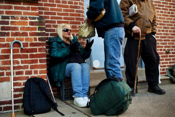"While in line at the United Church of Christ soup kitchen, Tony passes Andrea a bag full of her prescription medications. Before being homeless, Andrea suffered from a host of ailments that have only gotten worse, and now she needs both knees replaced. ""I'm living on painkillers,"" she says."