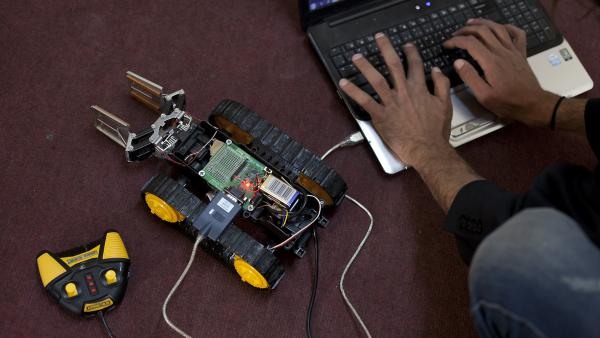 "Ahmad ""Harvester"" Heidar is a computer software engineer whose work for the Syrian rebels includes sweeping the hard drives of detained anti-government activists, and trying to develop a robot that will help extract sniper victims in Syria. Turkish officials have given Heidar the green light to develop a prototype of his robot, which he calls Tina."