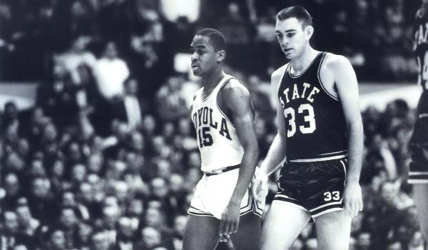 Mississippi State's Joe Dan Gold (33) and Loyola's Jerry Harkness (15) walk side-by-side during an NCAA game in East Lansing, Mich., in 1963.