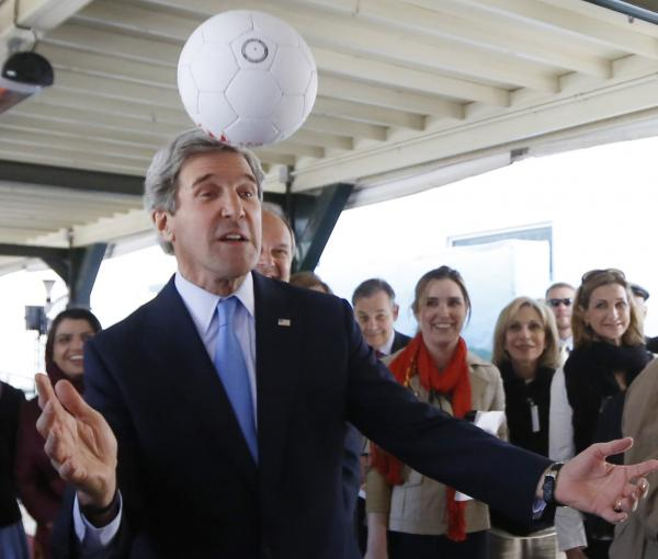 Secretary of State John Kerry using his head Tuesday in Kabul, where he met the captain of that nation's women's soccer team.