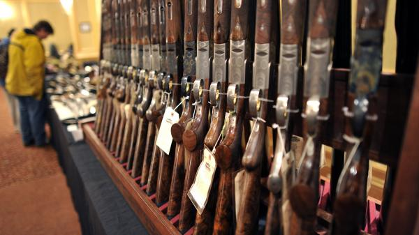 Shotguns sit on display at a gun show in Stamford, Conn. in January.