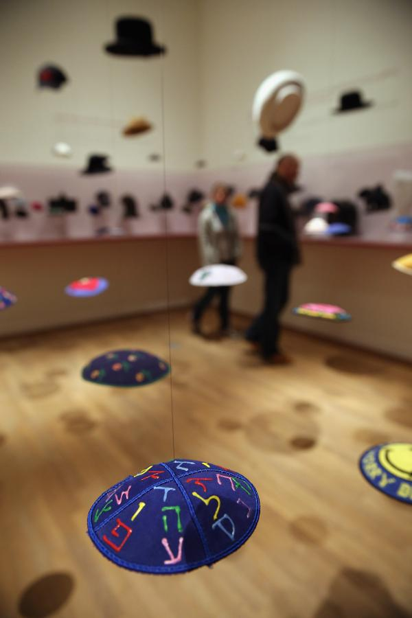 """The Whole Truth"" exhibit has a section that features yarmulkes, hats and other Jewish headwear."