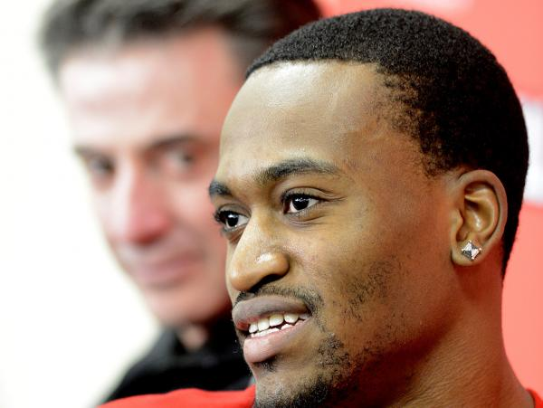 Louisville basketball player Kevin Ware talking with reporters Wednesday, as coach Rick Pitino looked on.