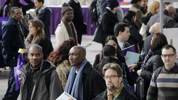 A crowd of jobseekers attends a health care job fair on Thursday in New York.
