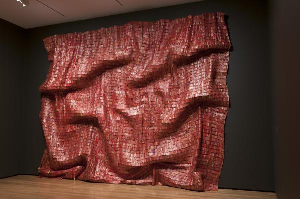 El Anatsui's<em> Red Block</em> (2010) explores the monumentality of a single color, suggestive of paintings by Mark Rothko or Gerhard Richter.