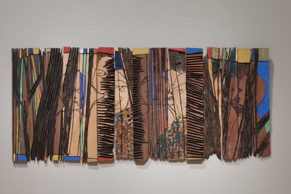 Anatsui's<em> </em><em>Conspirators</em> (1997) is made up of individual strips of wood that can be arranged differently each time it's installed.<em></em>