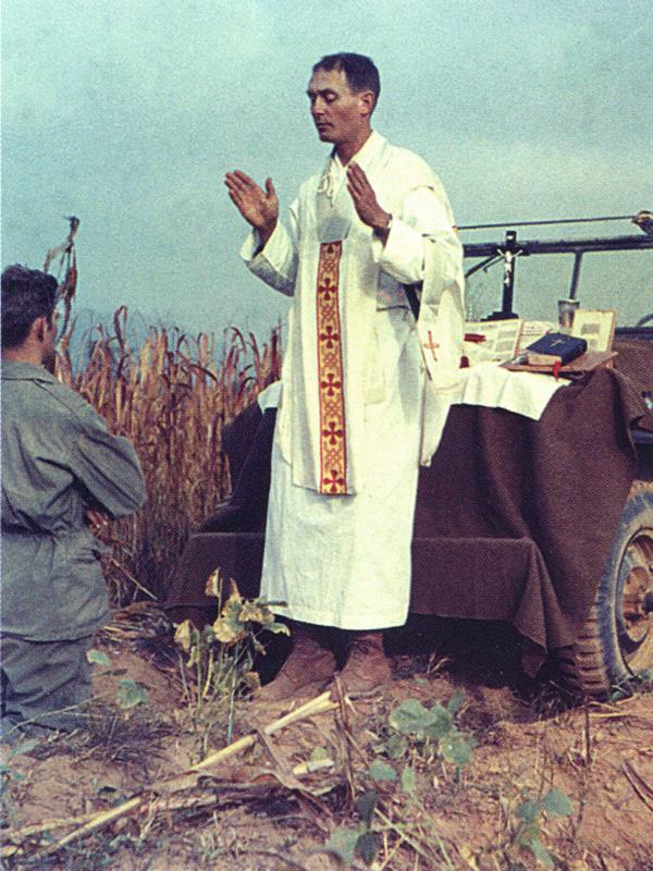 In a photo released by the Catholic Diocese of Wichita, Kapaun says Mass in the field during the Korean War.
