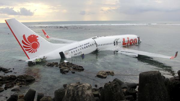 The wreckage of a crashed Lion Air 737 sits in water near the airport in Bali, Indonesia, Saturday, in a photo released by Indonesian police. All 108 people aboard survived the crash.